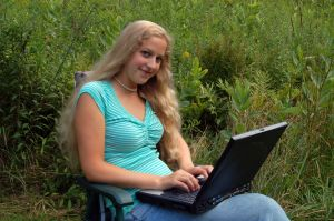 student-with-computer-outdoors-863796-m